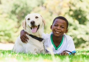 happy boy with dog   Ultimate Pet Nutrition