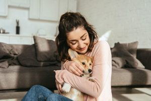 hugging puppy positive reinforcement | Ultimate Pet Nutrition
